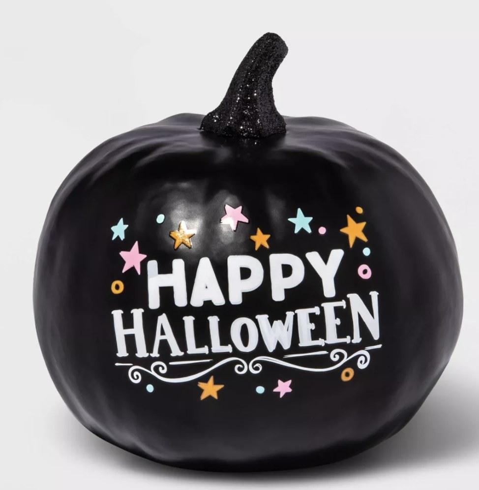 "Black painted ""Happy Halloween"" pumpkin"