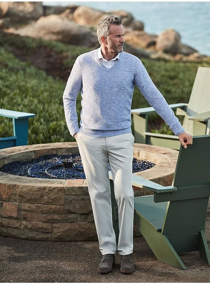 model wearing reserve collection non-iron chino pants in light grey