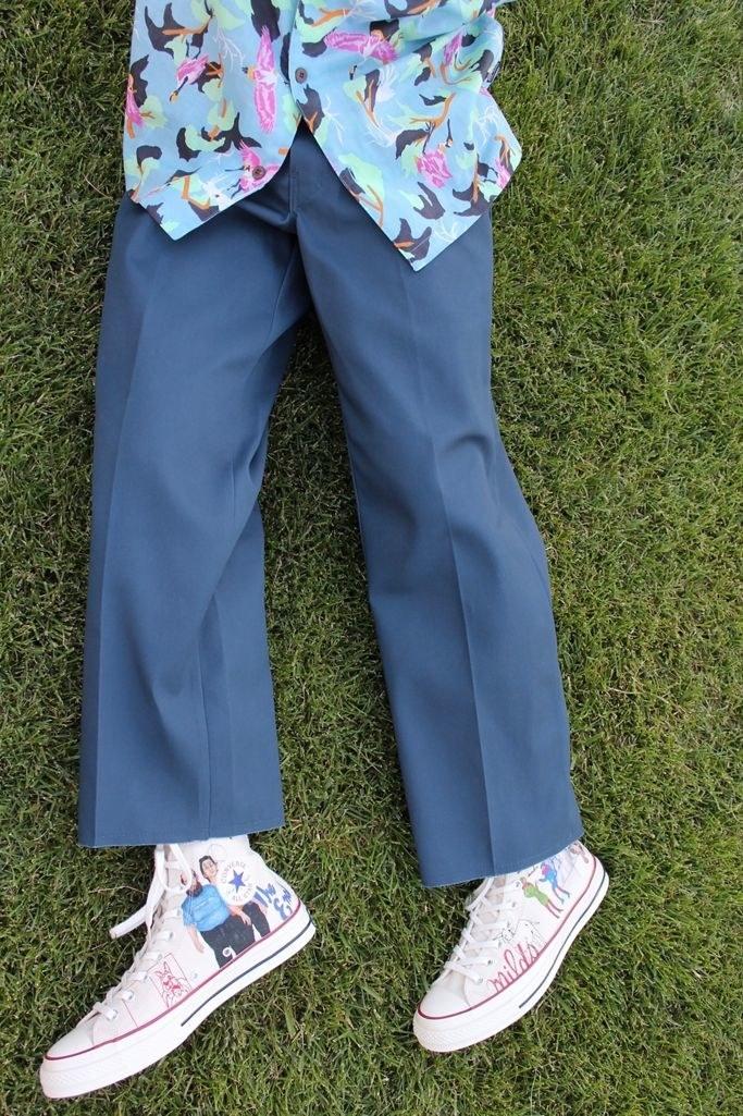 model wearing Dickie's cutoff work pants