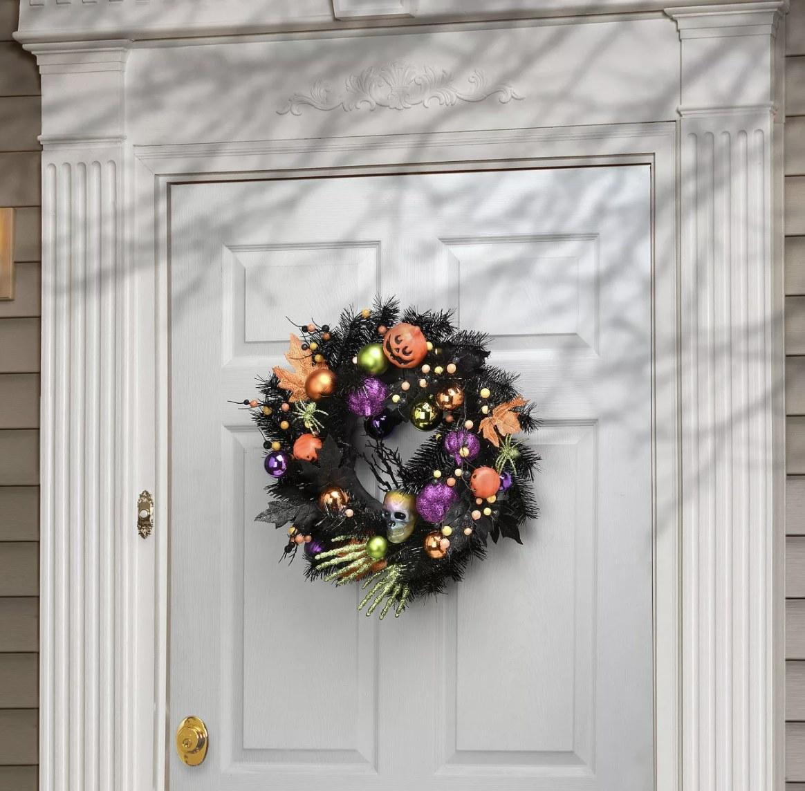 Pumpkin and ornament wreath on front door