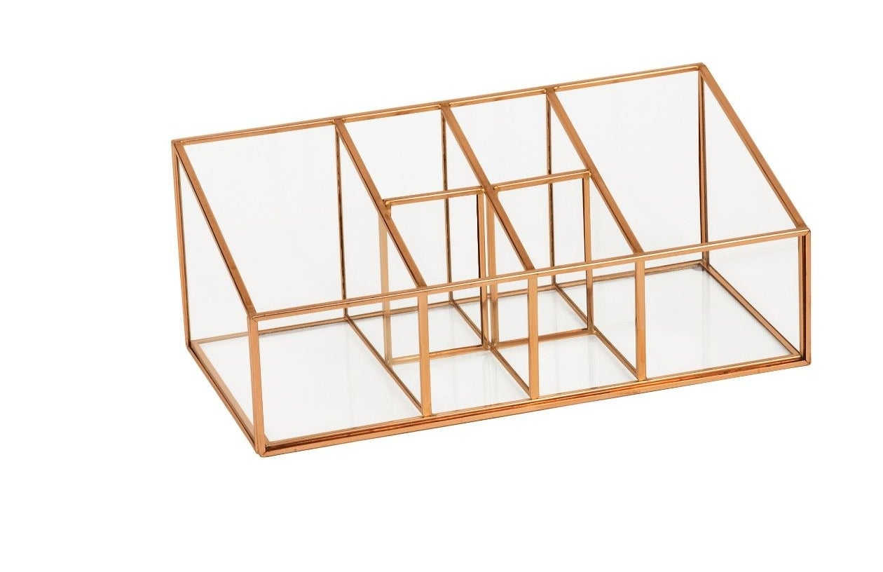 The rectangular organizer, which has two large sections, four smaller sections, and a dipped front panel