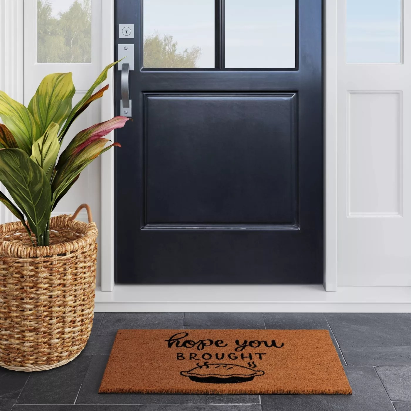 """The doormat that reads """"Hope you brought pie"""""""