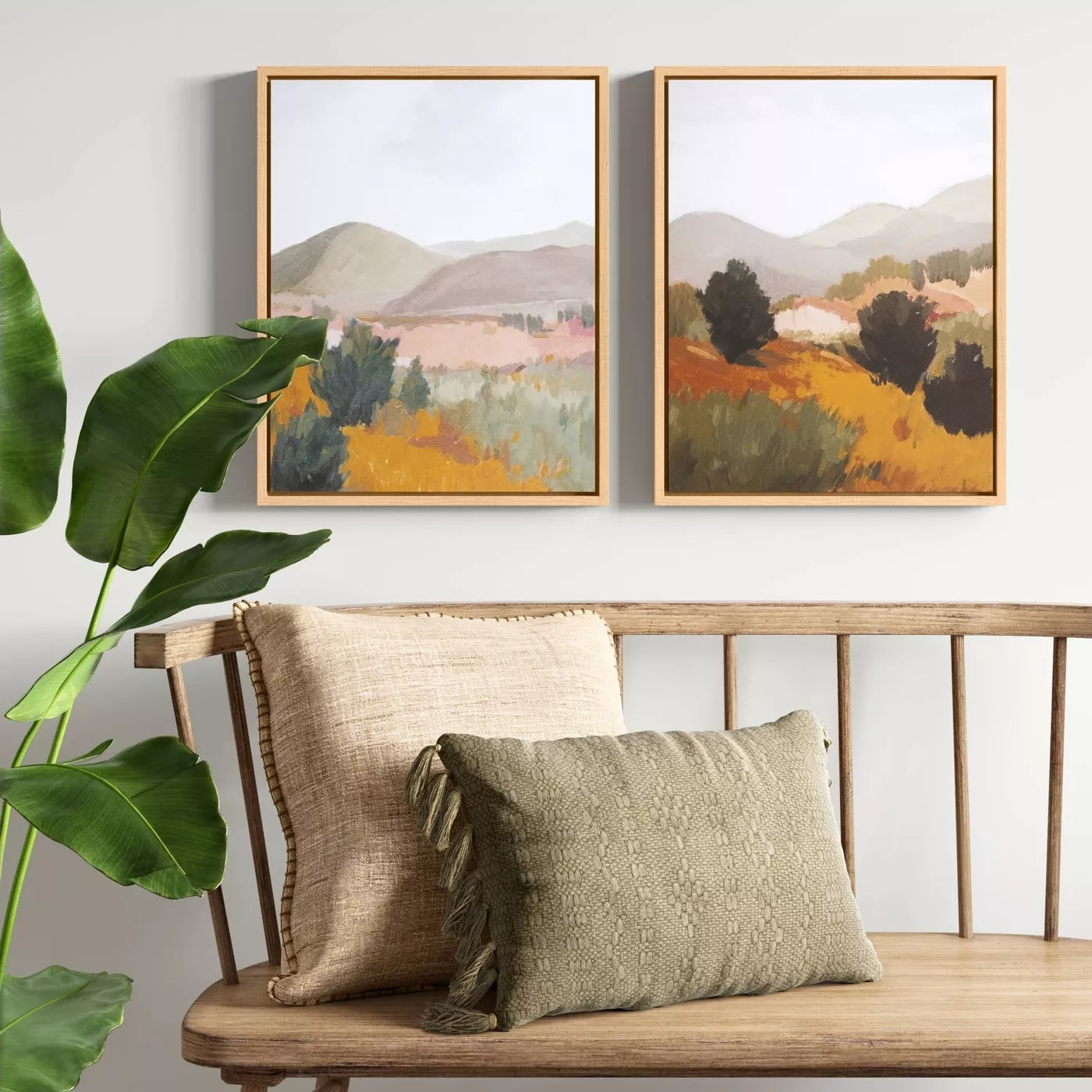 The paintings hanging next to each other on a wall