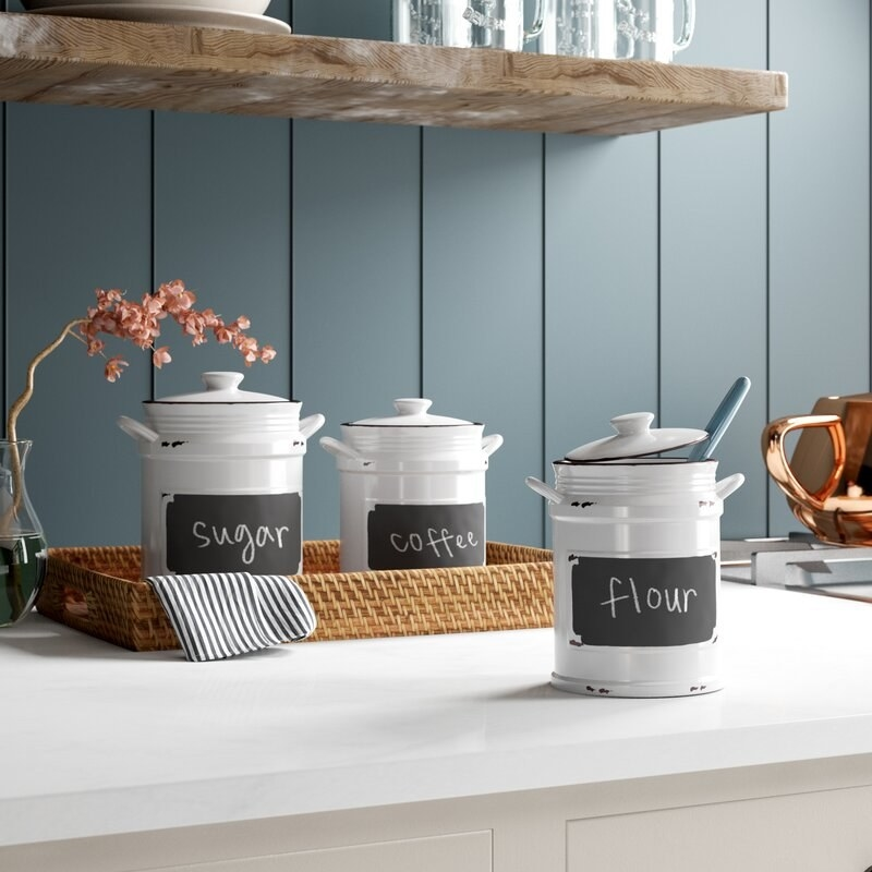The three canisters in kitchen