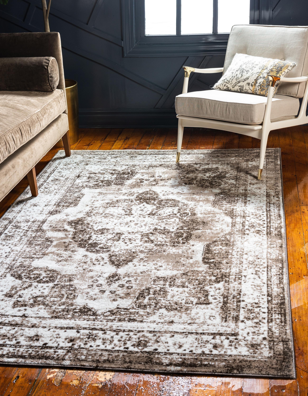 Distressed vintage rug in light brown