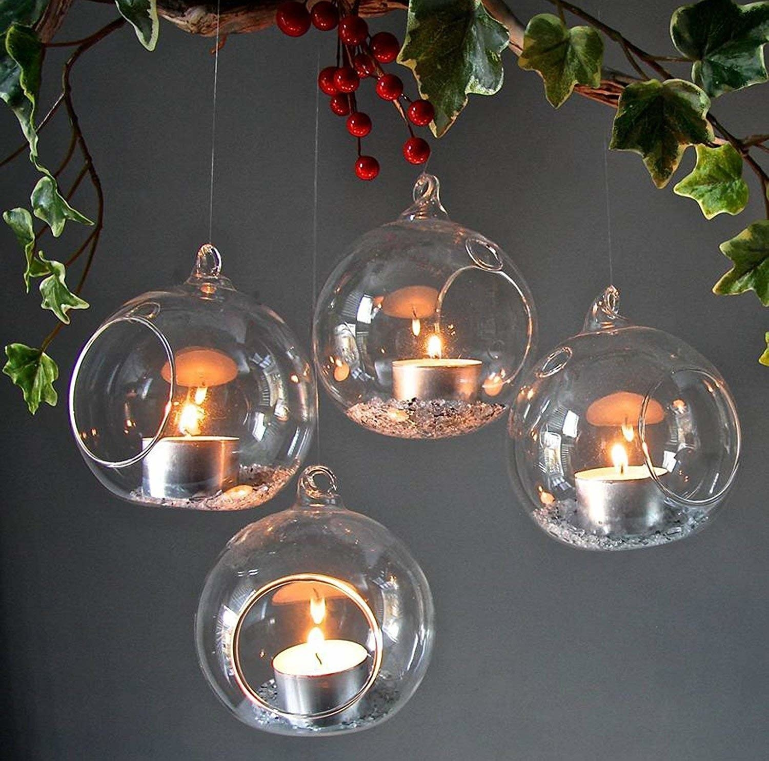 The glass holders used to house tealight candles and grey sand.