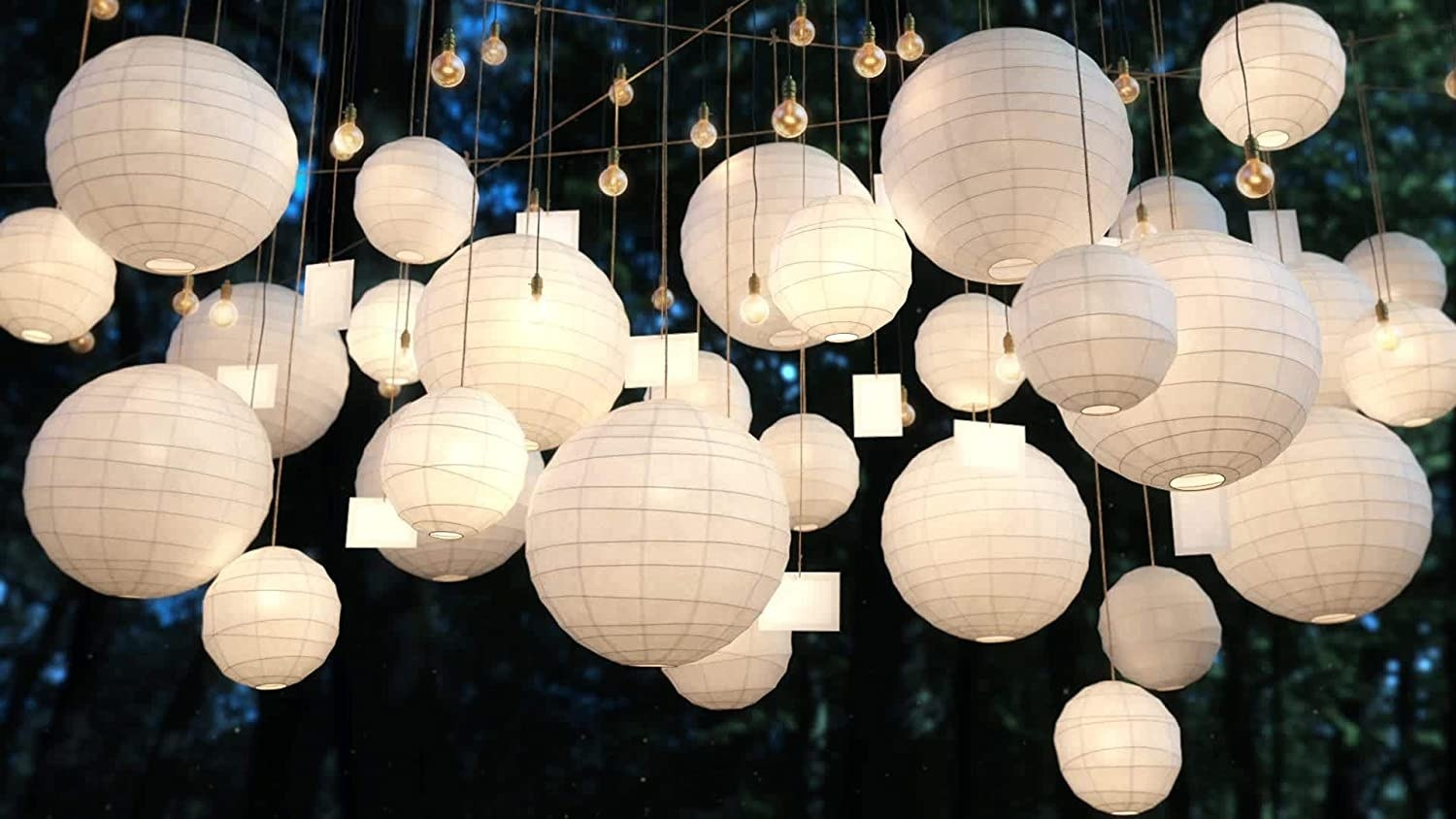 Paper lanterns and lights hung up on strings.