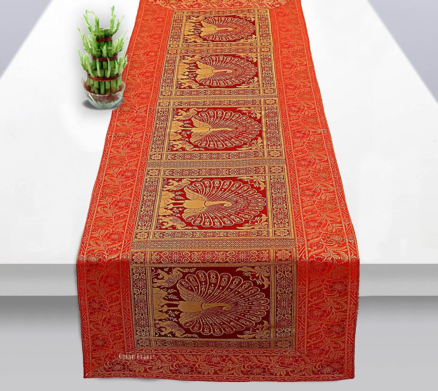 A red and gold table runner