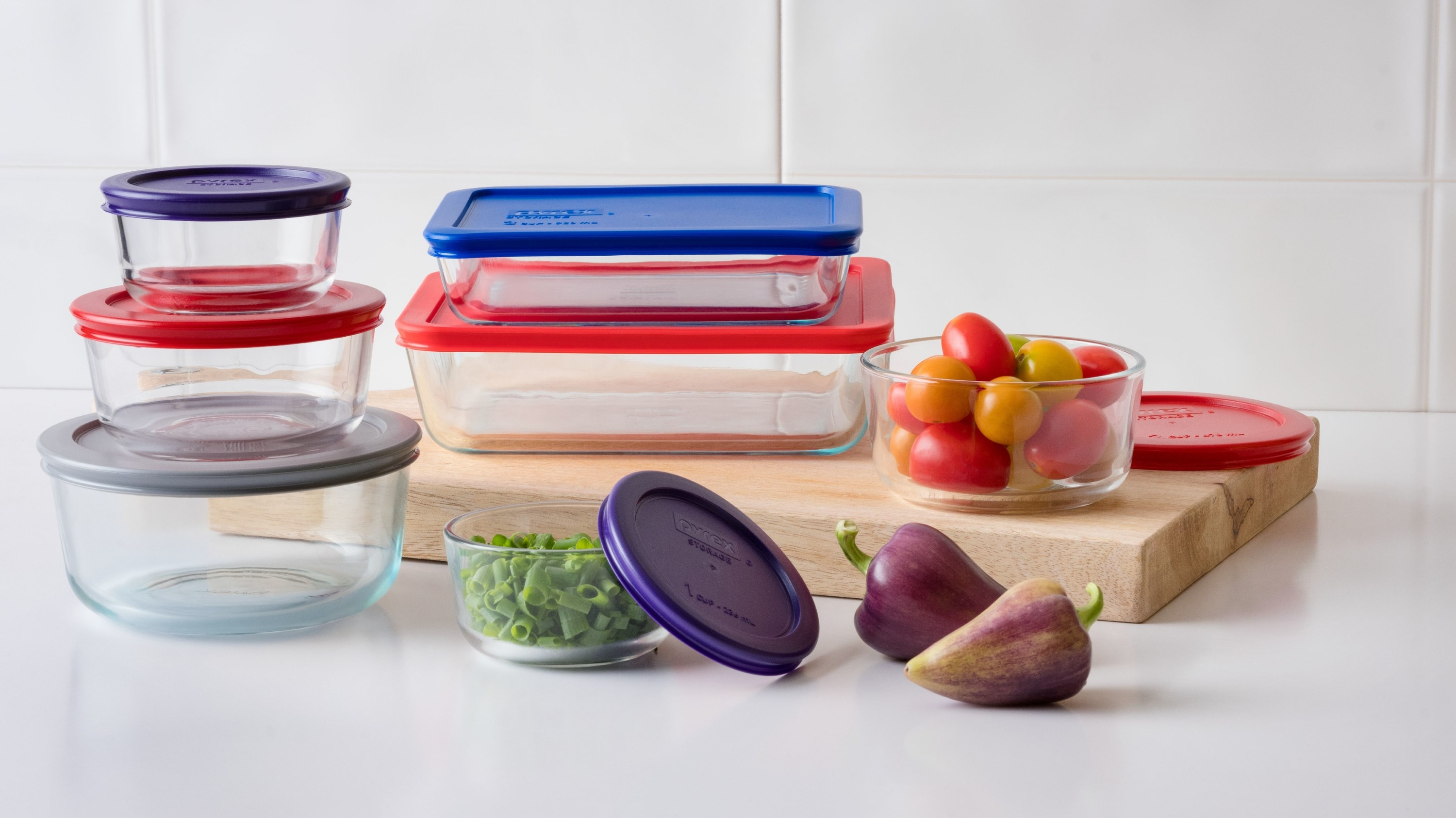 Pyrex bakeware set with purple, gray, red and blue lids