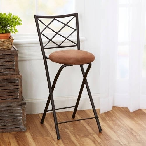 X-back folding stool in tan