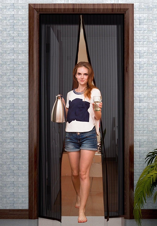 Model walks through the black mesh screen door