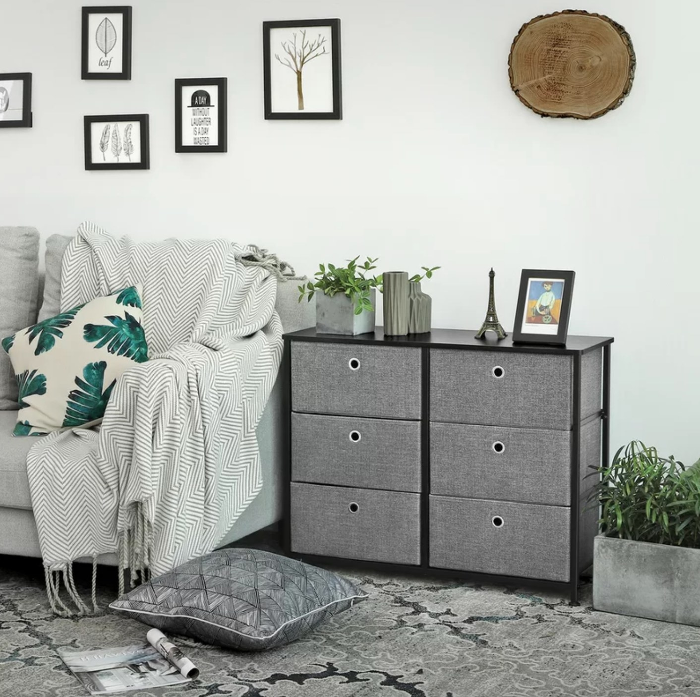 The six-drawer double dresser with gray felt drawers set in a black metal frame
