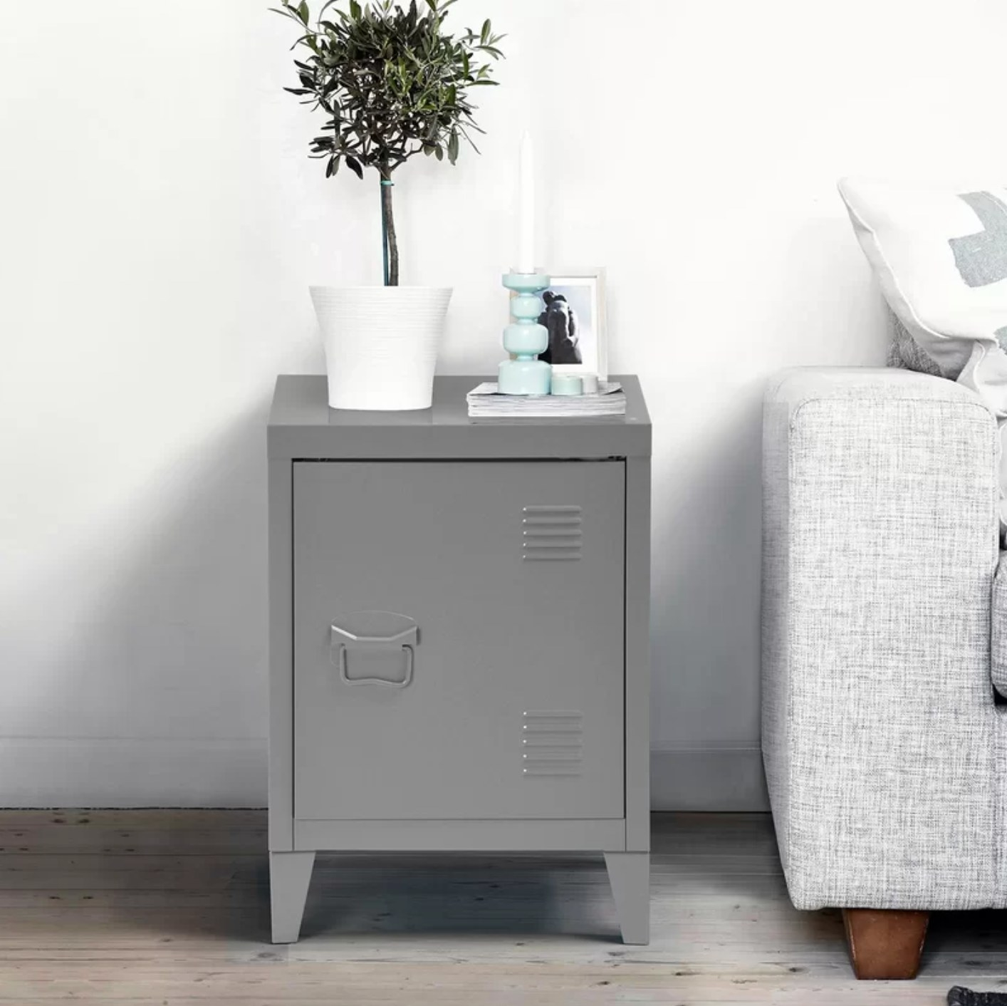 The metal nightstand in dark gray with school locker detailing