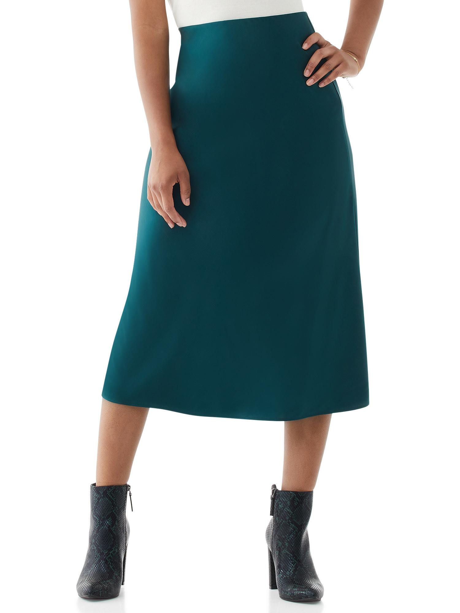 Model in midi slip skirt nad snakekin booties