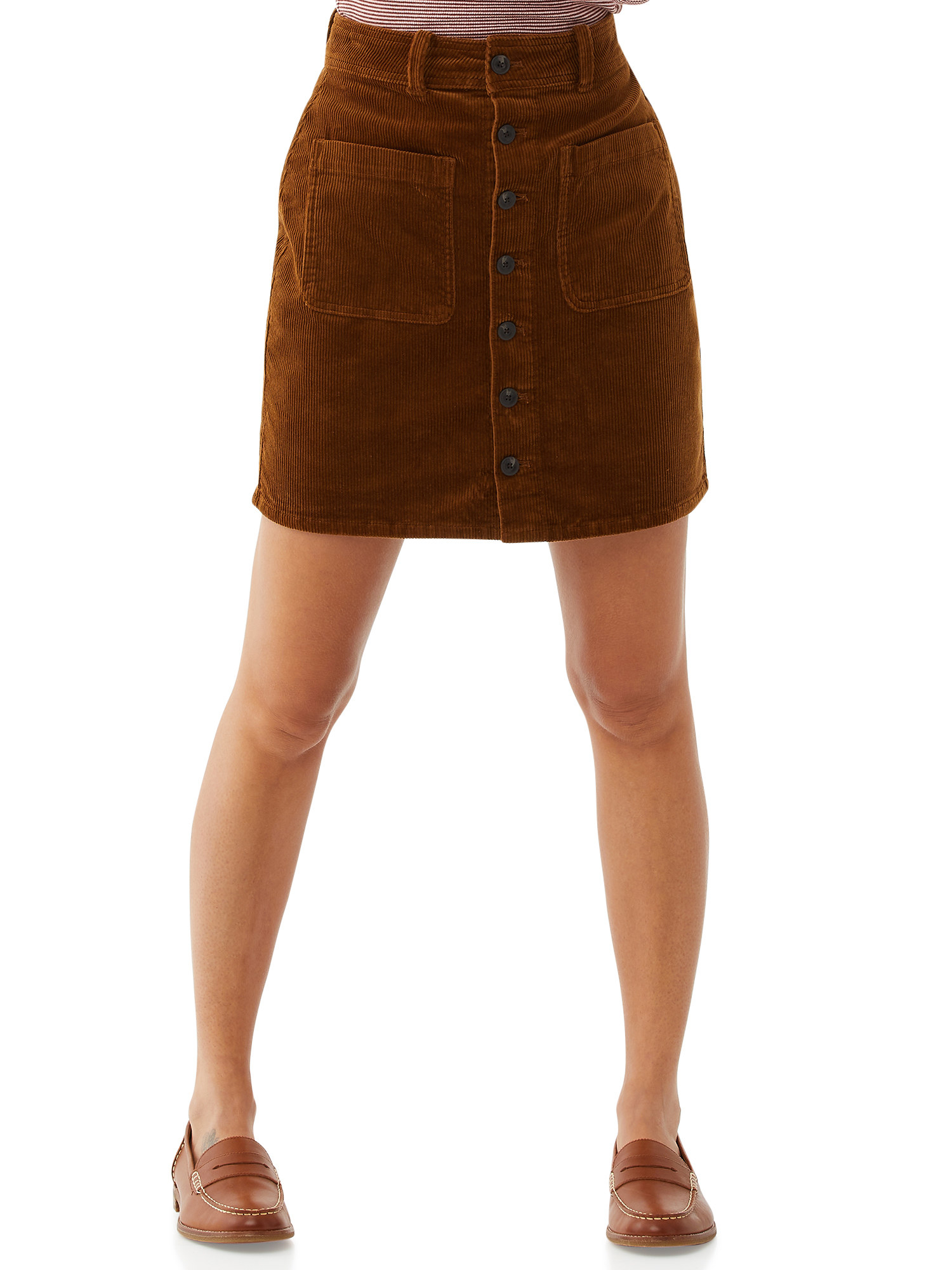 Model in brown corduroy button-front skirt with loafers