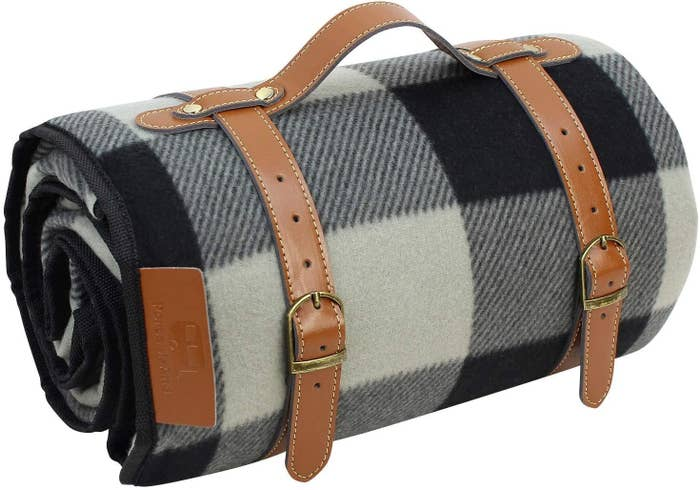 plaid blanket with leather strap and carrying handle
