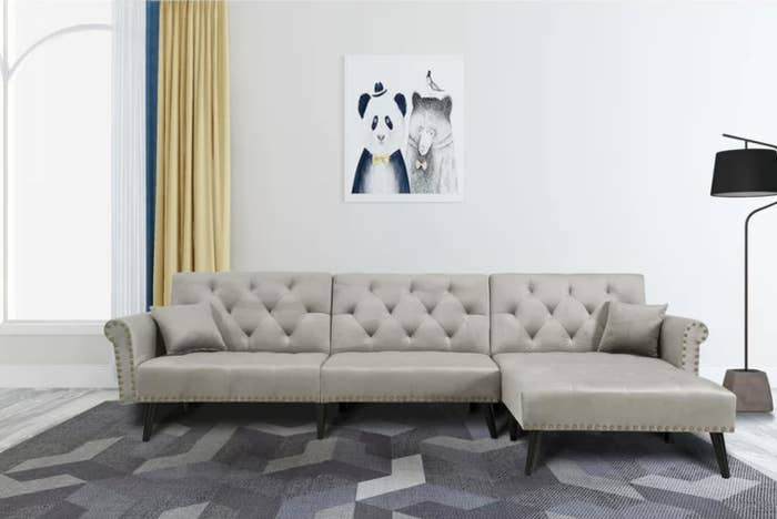 The velvet reversible sleeper sofa and chaise in gray velvet