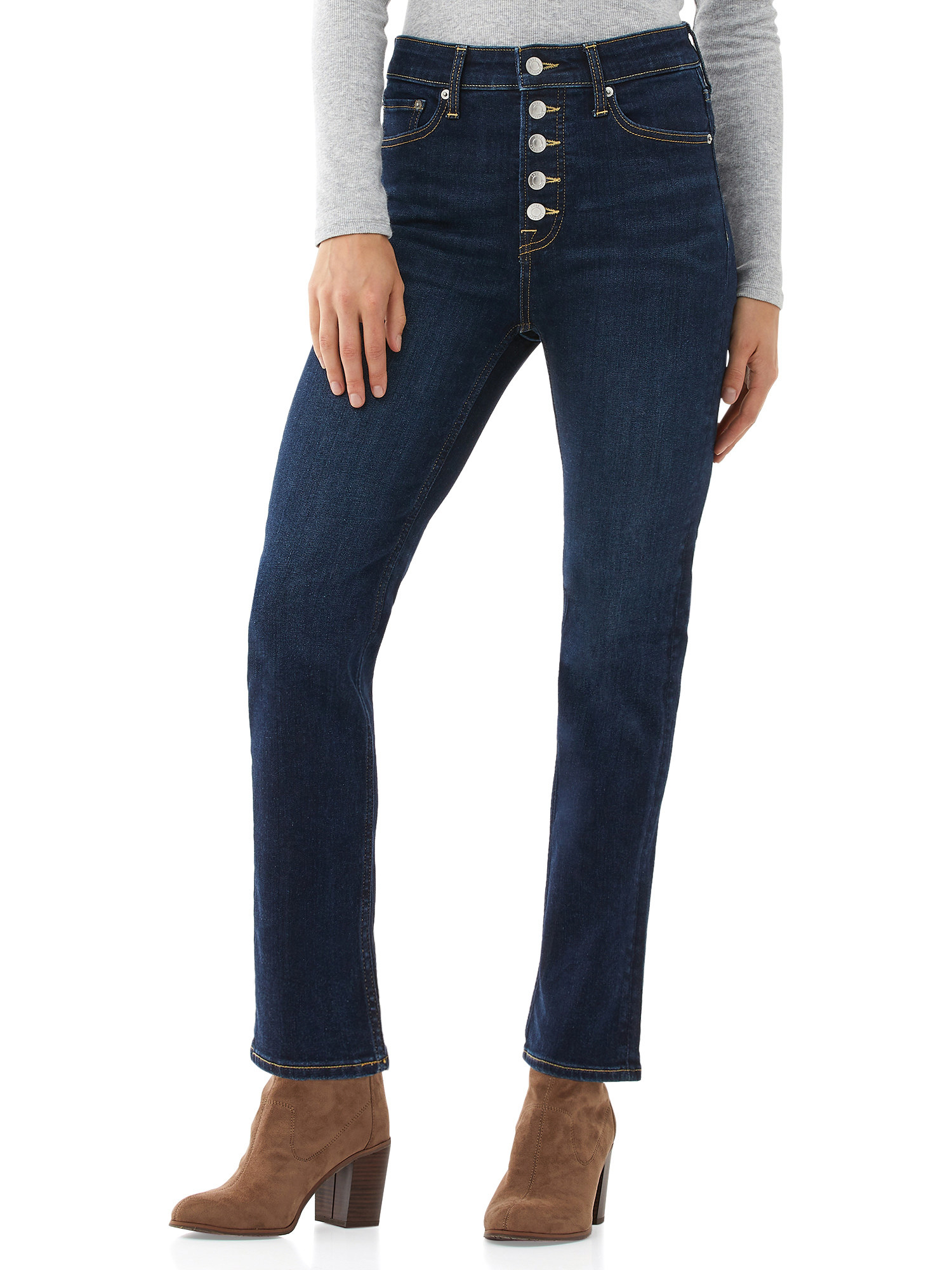 Model in button front jeans and brown booties
