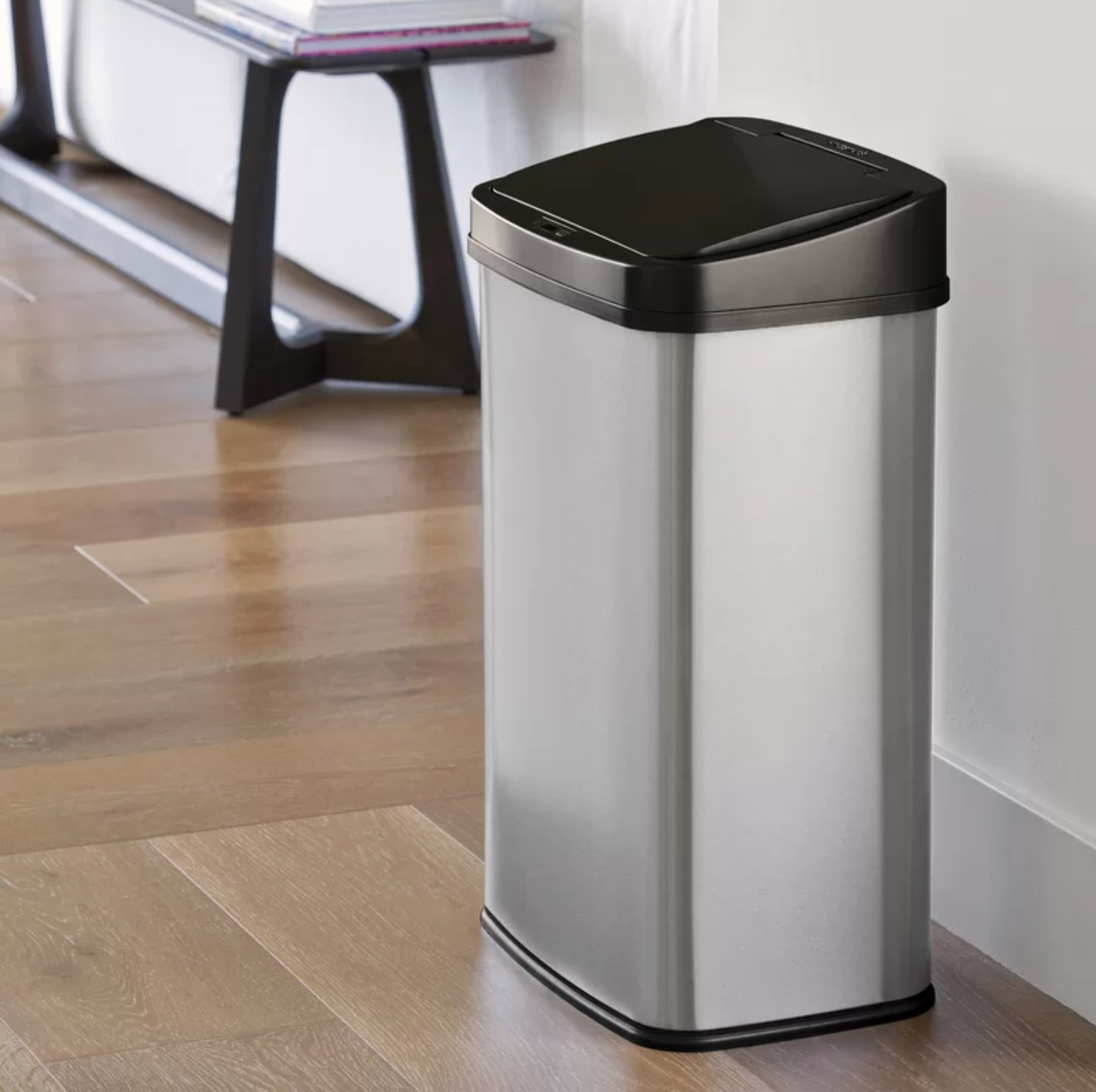The stainless steel trash can with a black motion censor lid