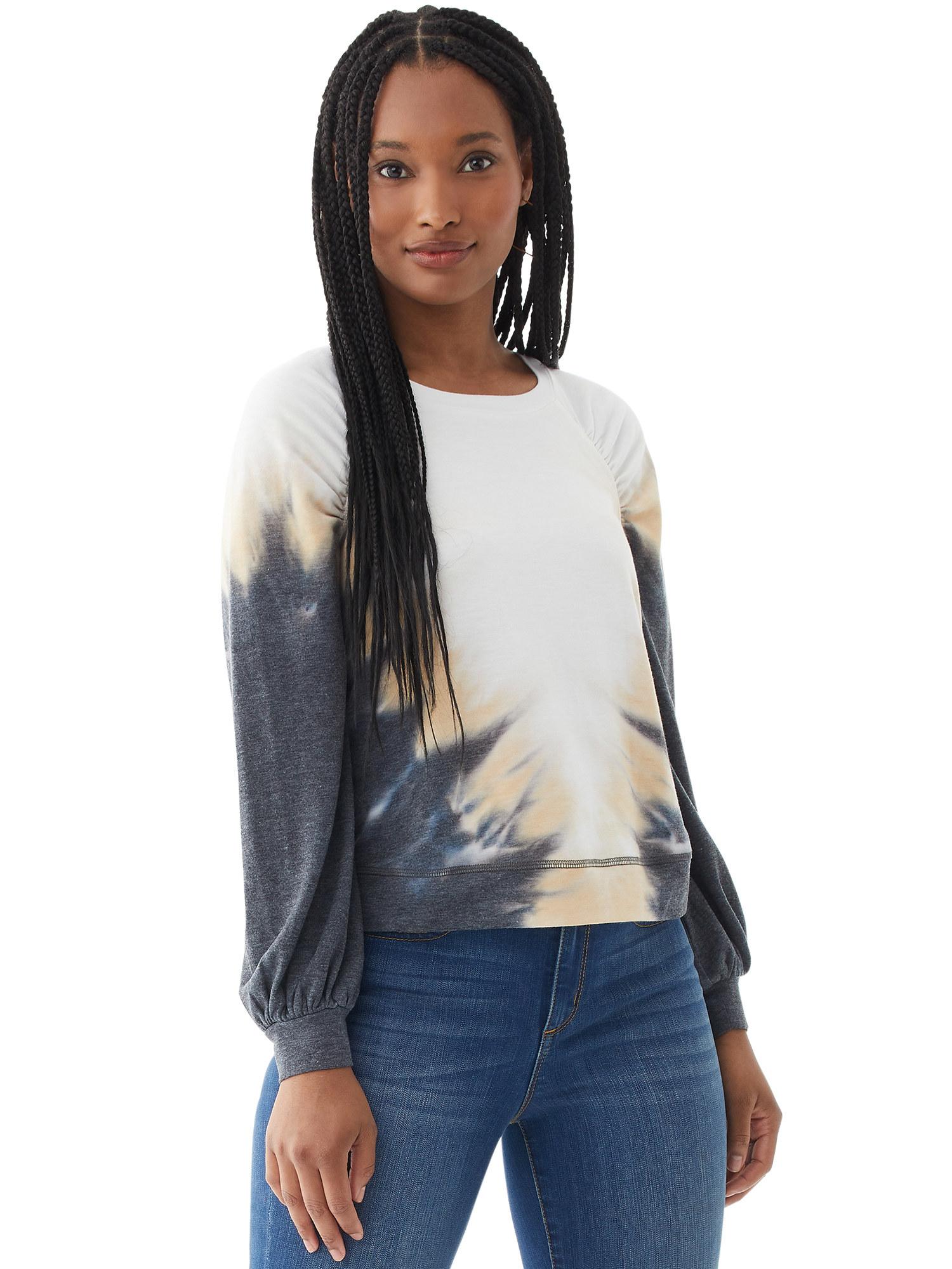 Model in tie dye sweatshirt and jeans