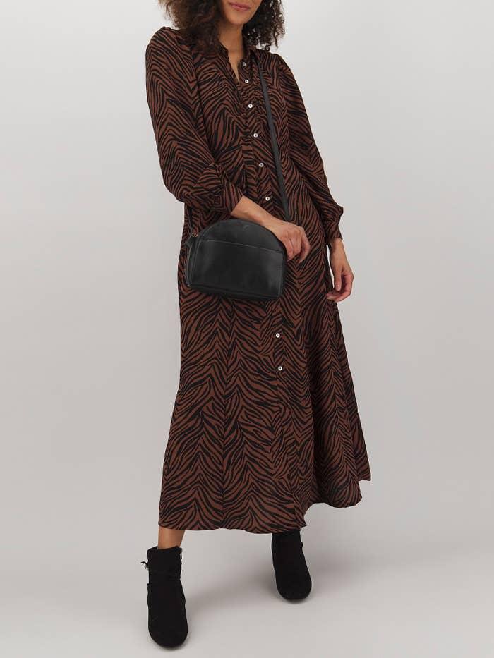 Model in printed puff sleeve maxi skirt dress