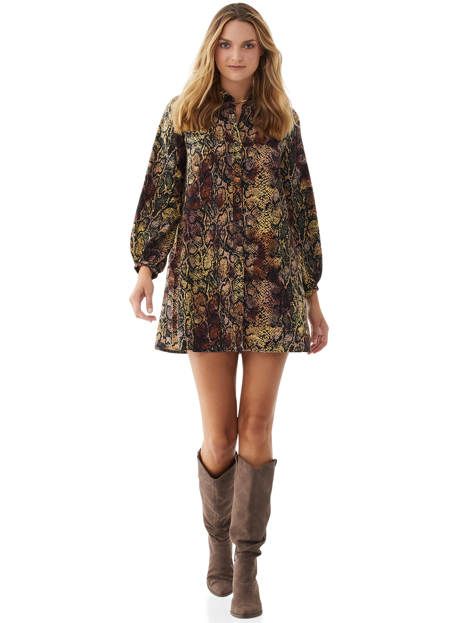 Model in snakeskin shirtdress and brown boots
