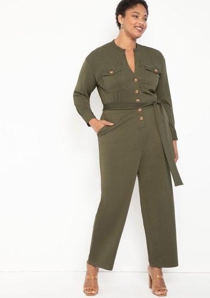 Model in green knit jumpsuit