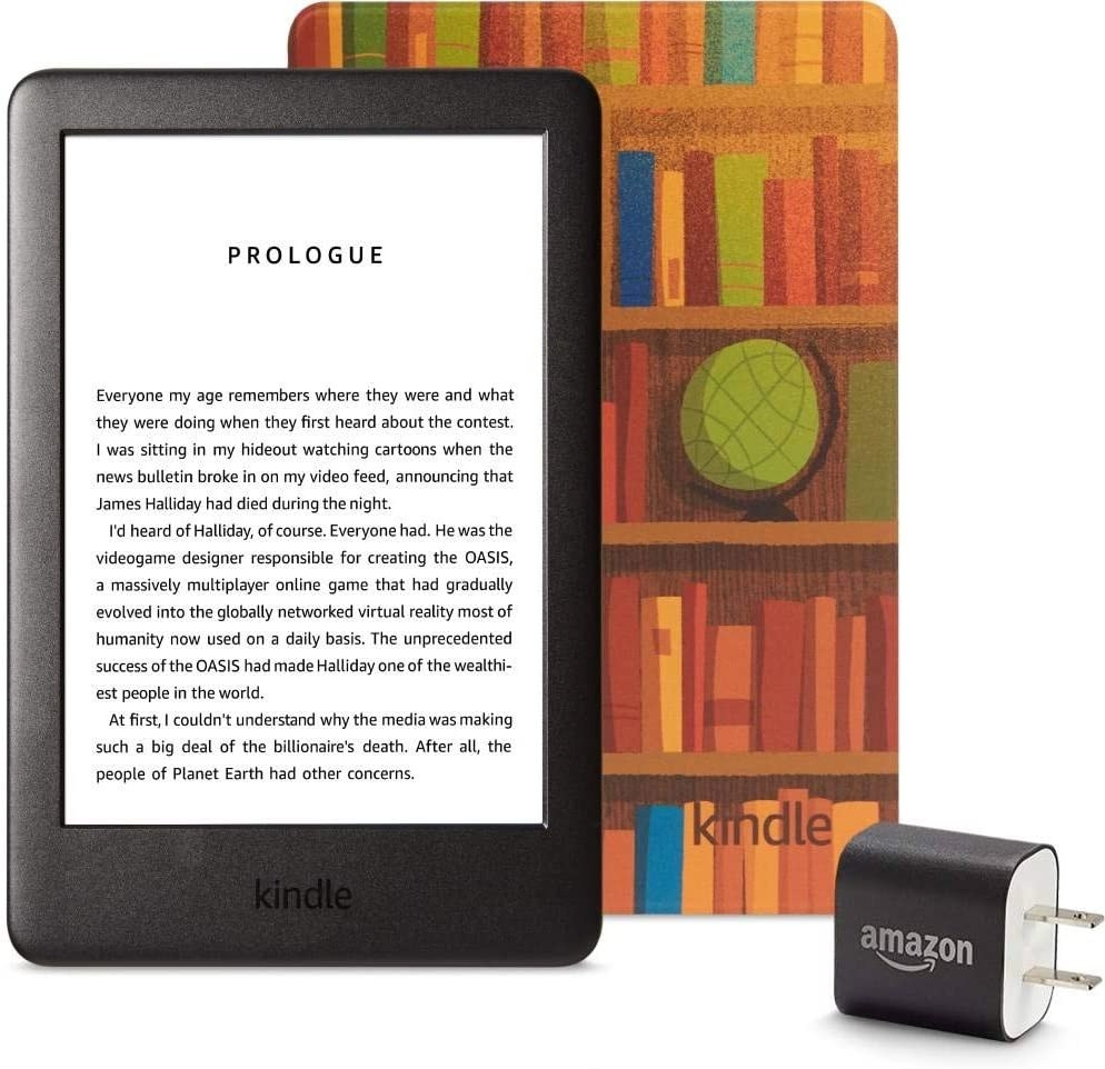 The kindle, the cover covered in an illustration of bookshelves, and a wall charger