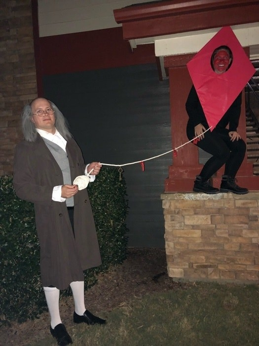 Someone dressed as Ben Franklin, and another dressed as his red kite