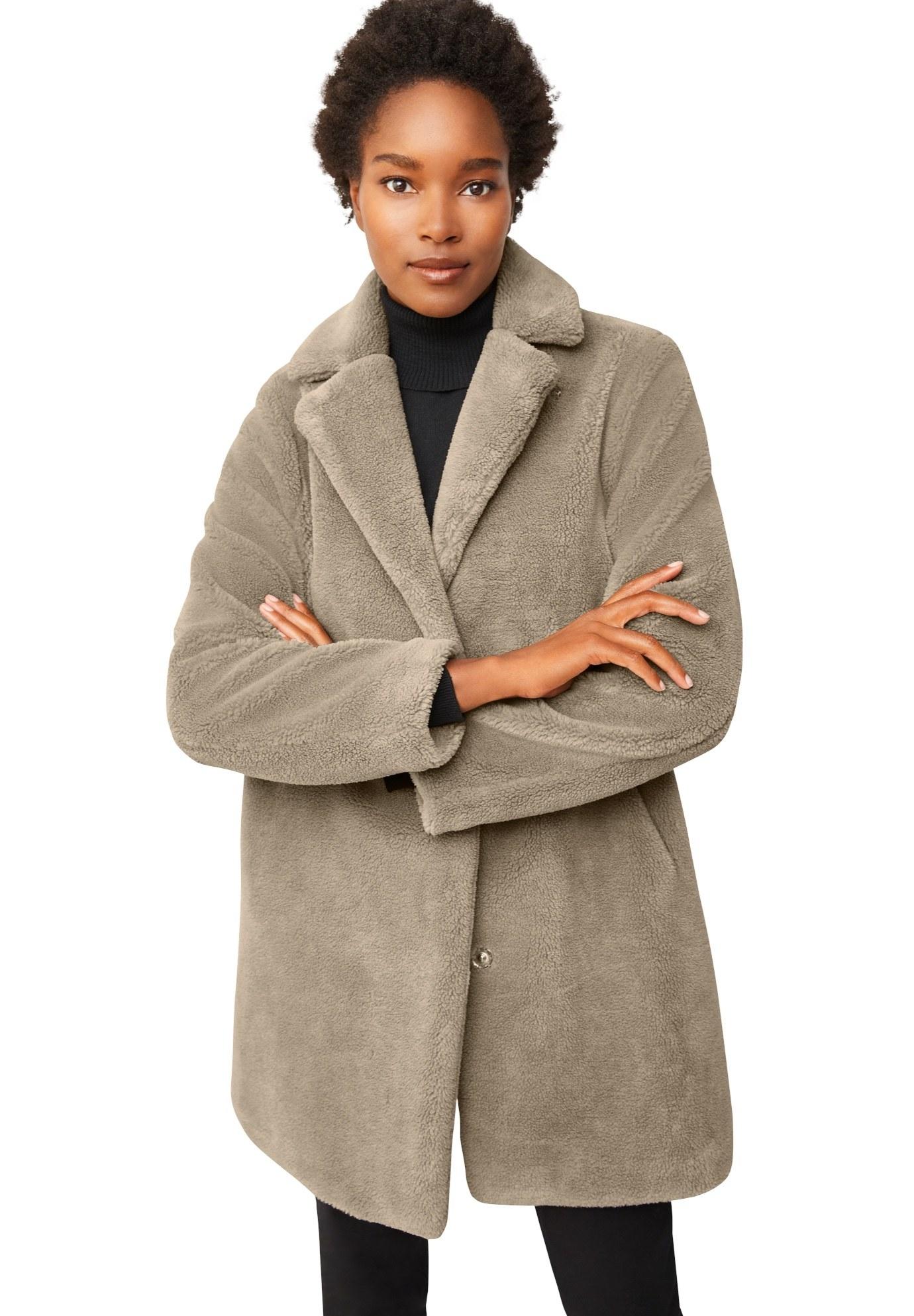 Model in faux fur teddy coat