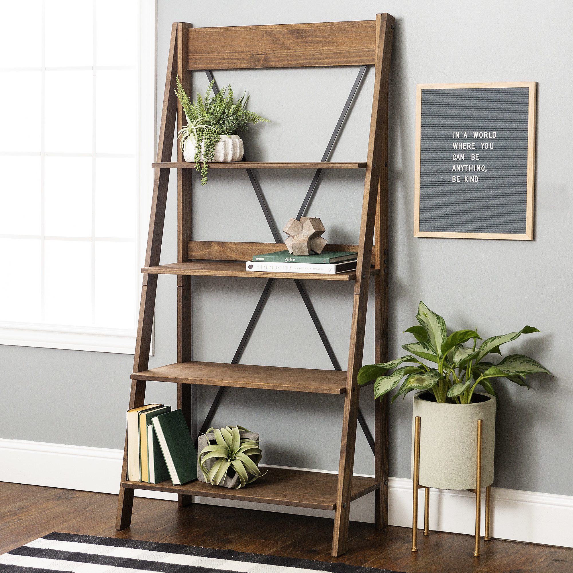The bookshelf with four shelves, which get narrower as they get higher up