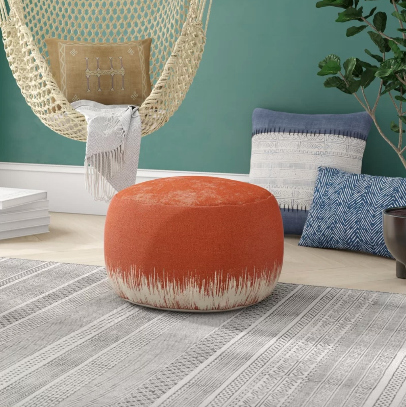 The round abstract pouf ottoman in clay
