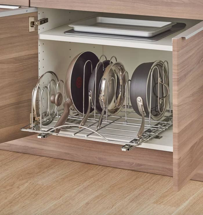 The sliding pot organizer pull out drawer made with silver metal
