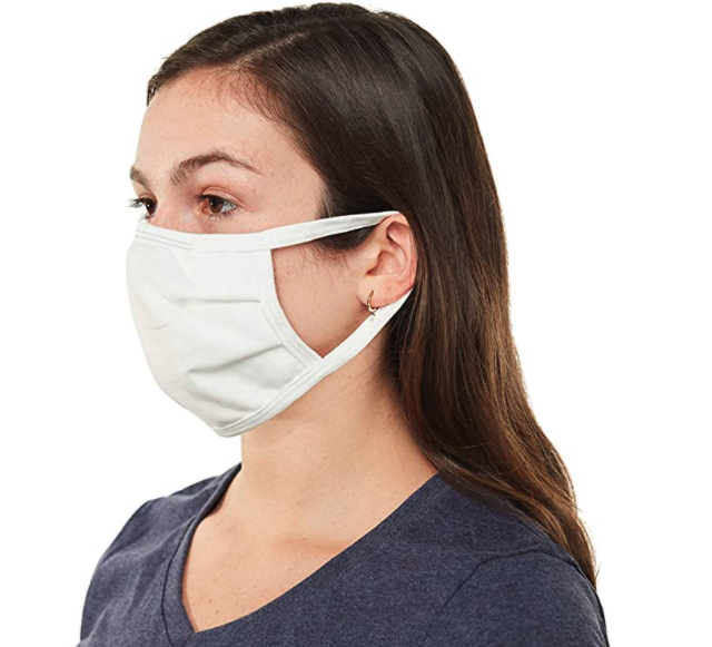 A model wears a white cloth face mask