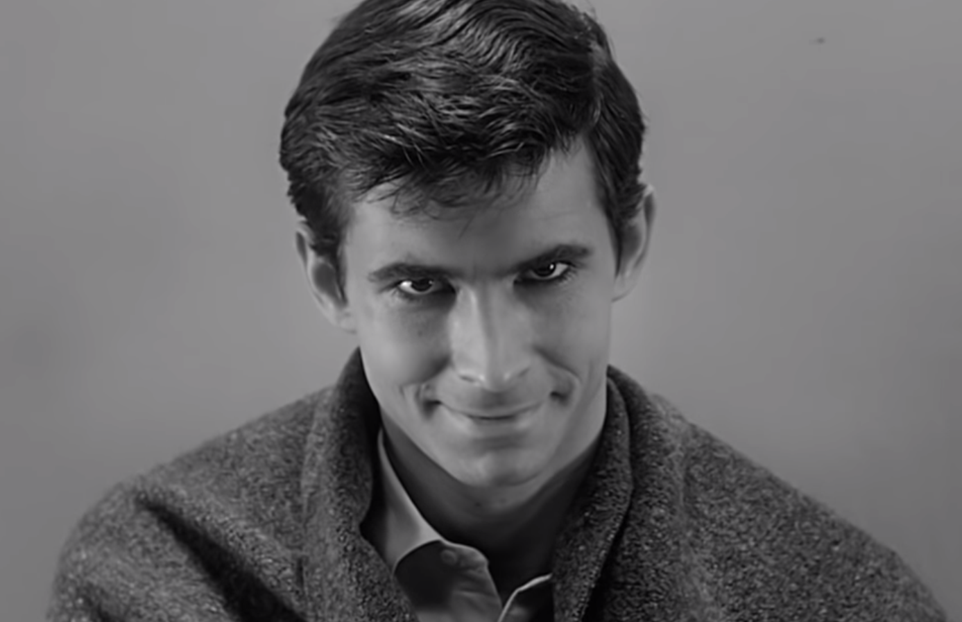 Norman Bates staring creepily into the camera in his prison cell