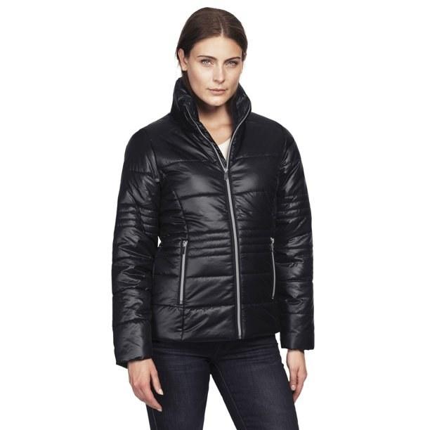 Model in short puffer zip front jacket