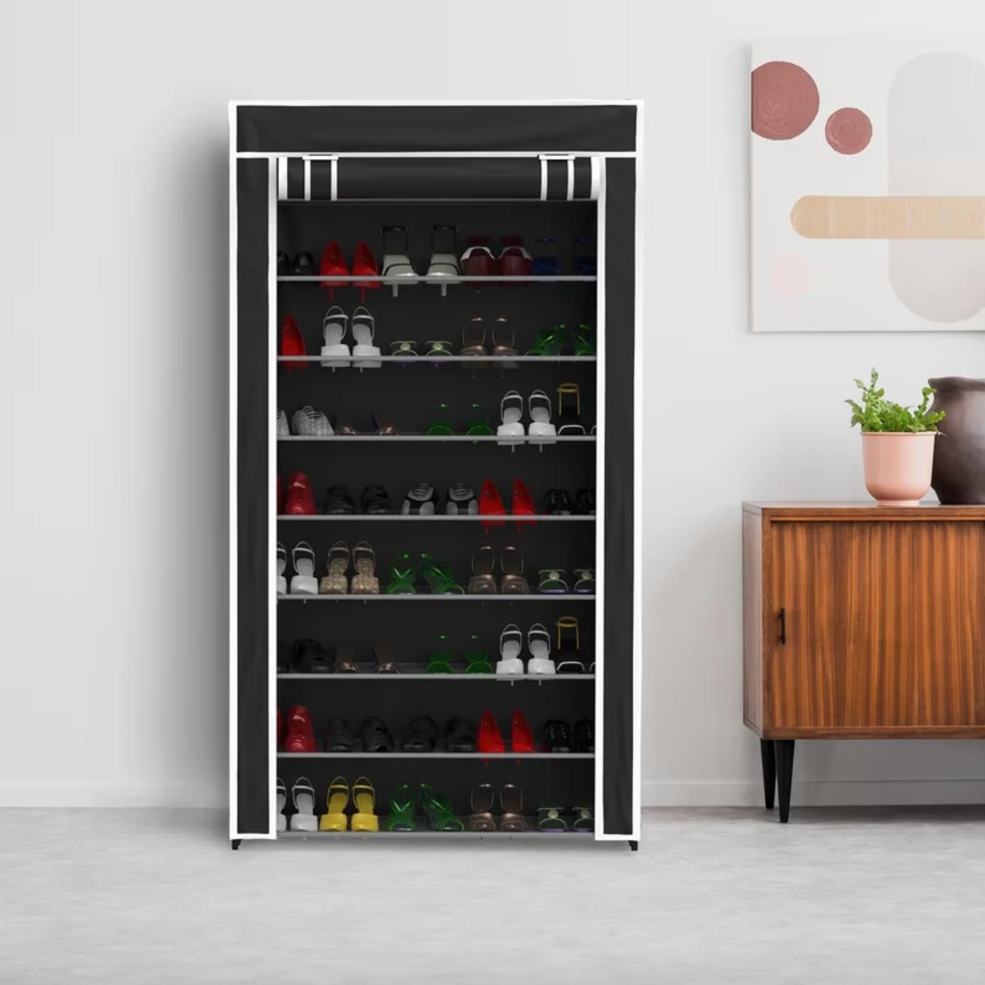 The nine-tier shoe rack in black and white with a curtain