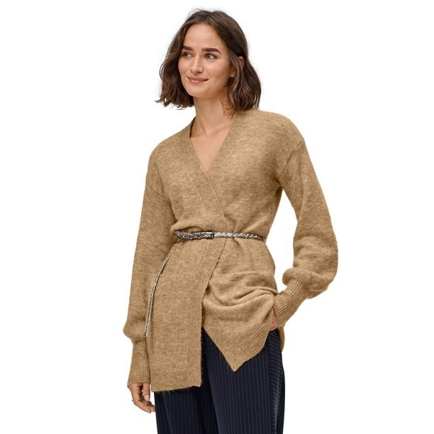 Model in cardigan with puffy sleeves