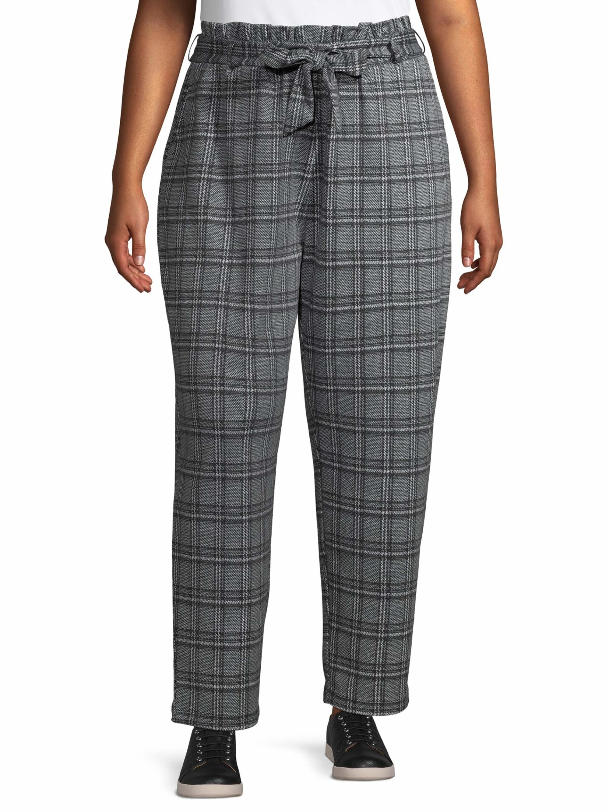 Model in plaid paper bag waist pants