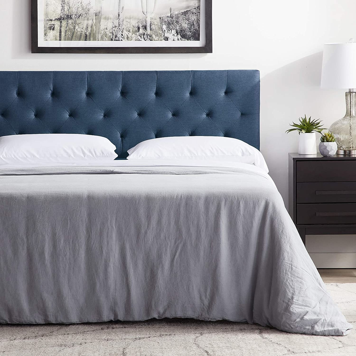 The tufted headboard in cobalt blue
