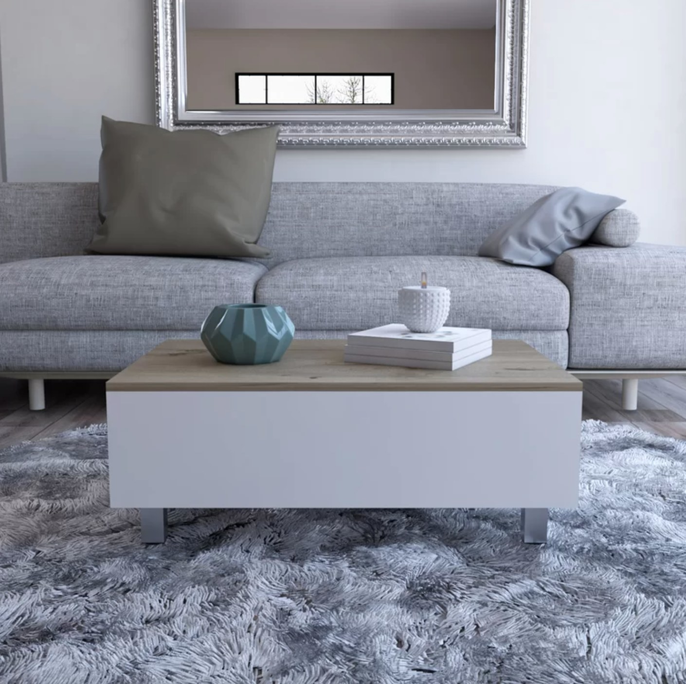 The lift top coffee table with storage in white with silver metal legs and a wood top