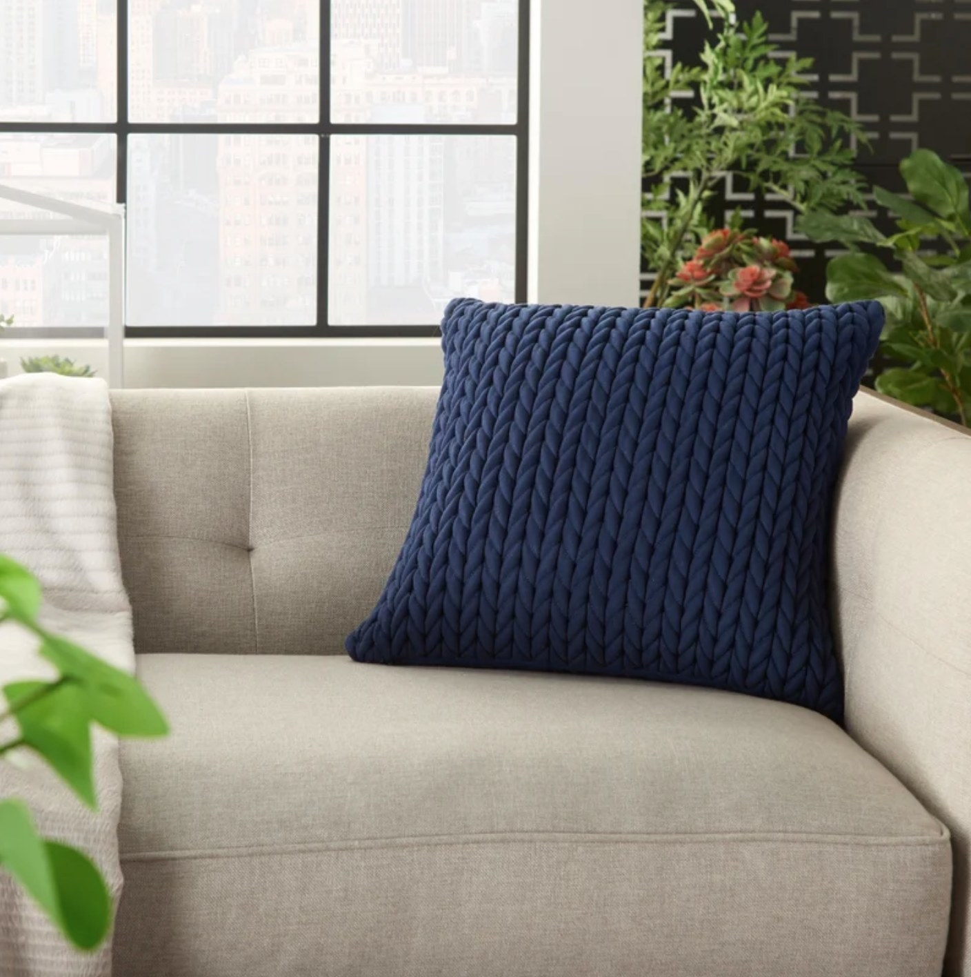 The quilted square pillow cover and insert in navy blue