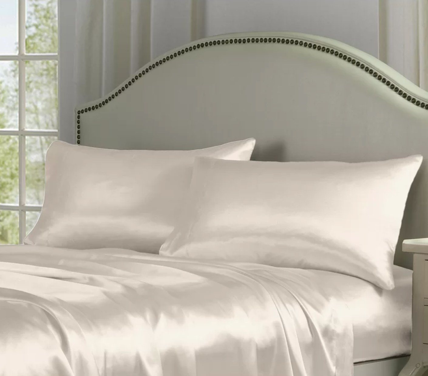 The satin sheet set in ivory