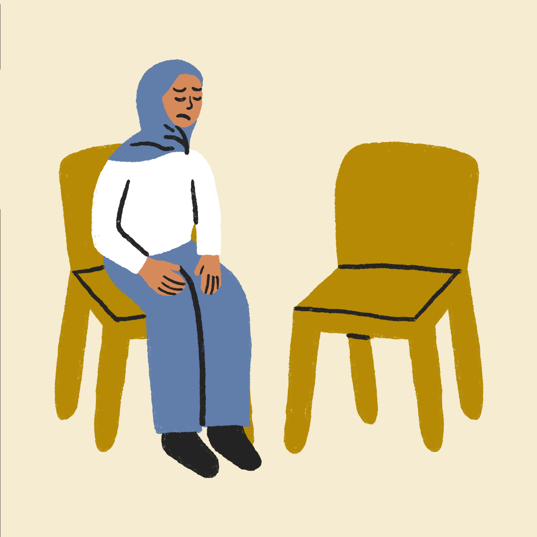 a person staring at an empty chair