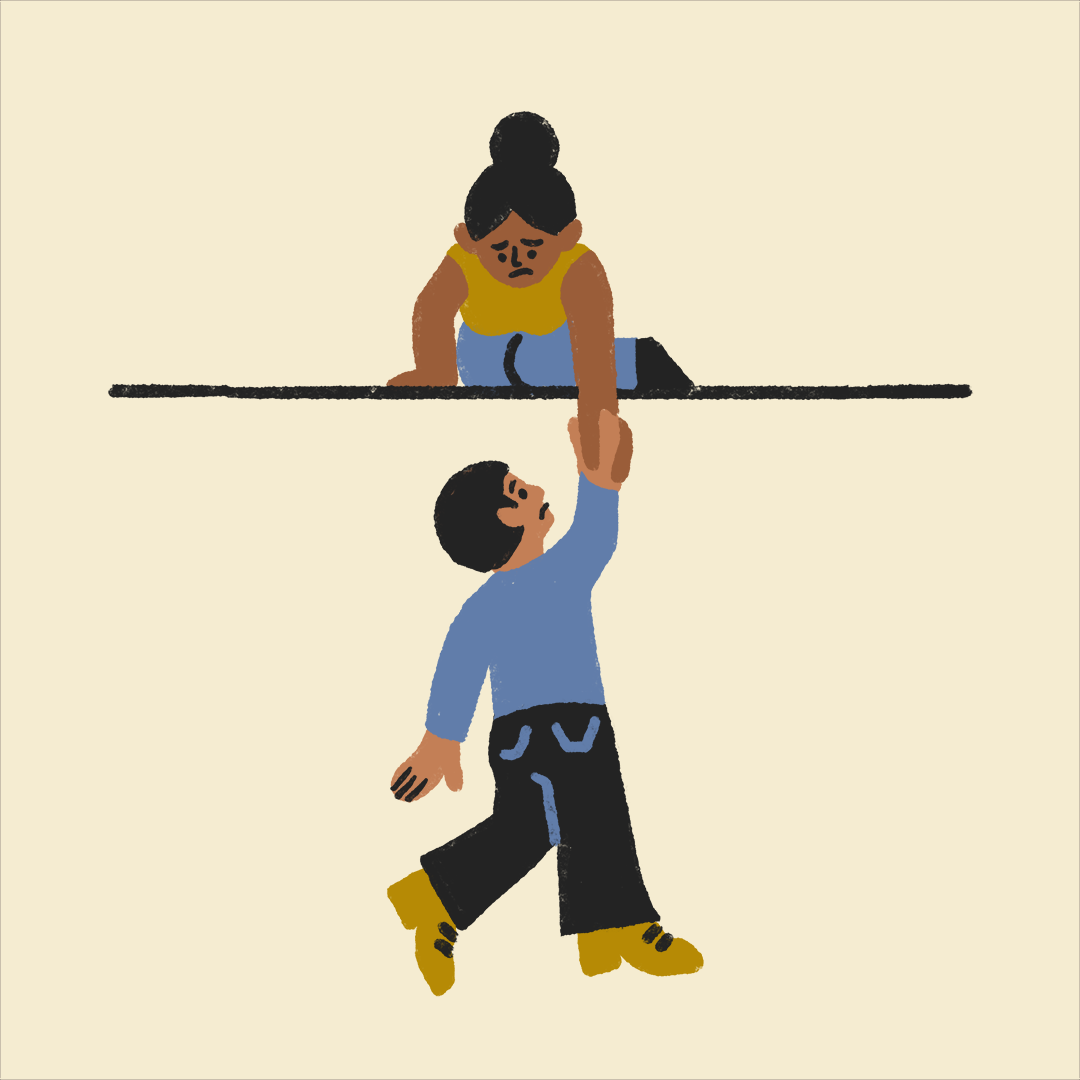 a woman holding onto their friend, who has fallen and is dangling
