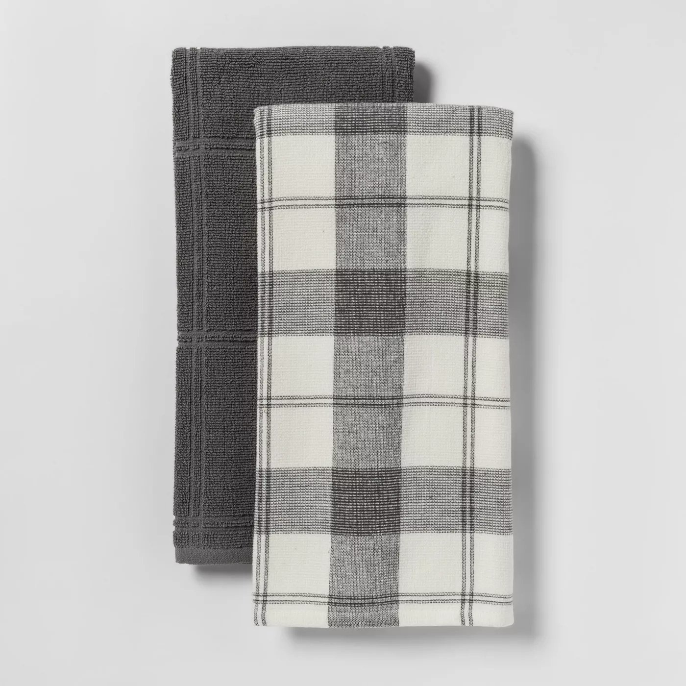 The towel set, which includes one solid towel and one with a checkered pattern