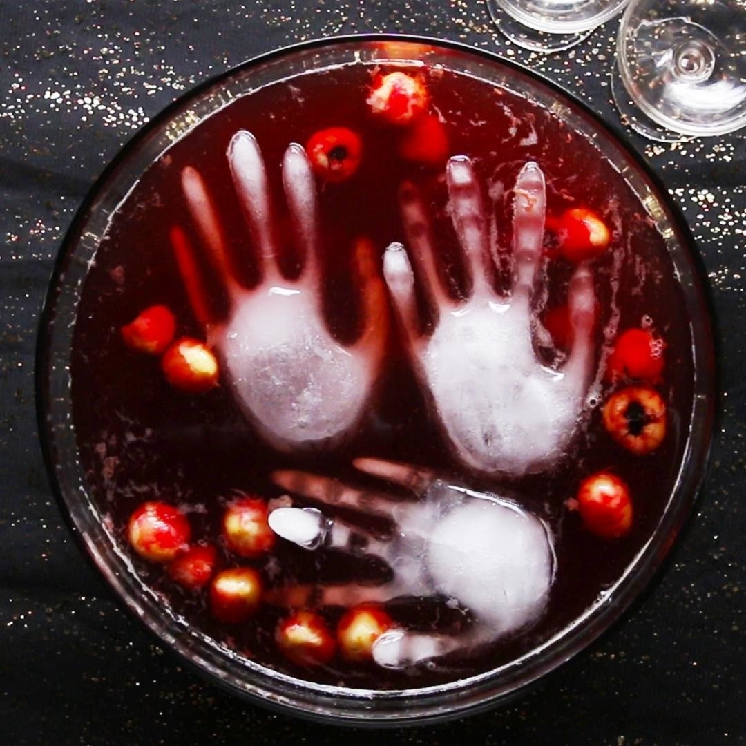 bowl with red punch and hand-inspired ice cubes