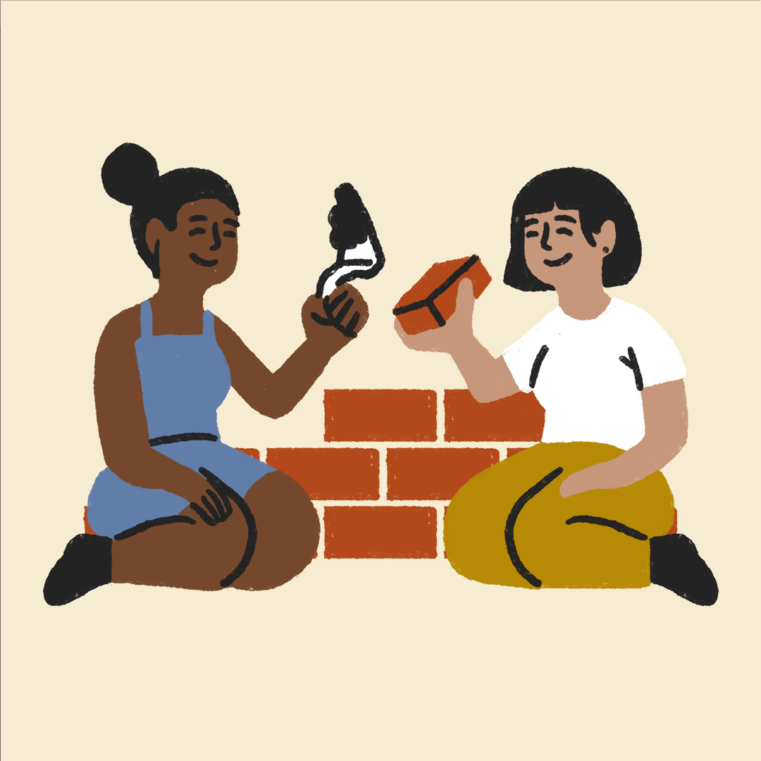 two people building a brick wall together, smiling