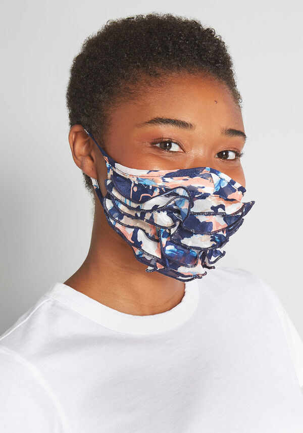 frilly mask in blues and pinks
