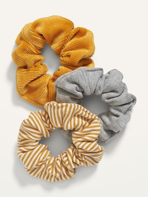 A three-pack of scrunchies in a variety of colors and patterns